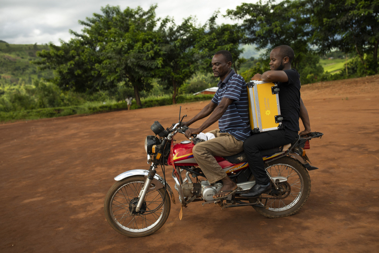 Sunbox Ambassador riding on motorcycle in Malawi